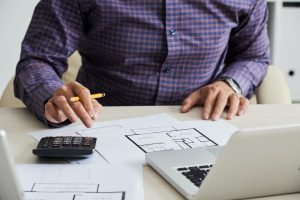 Man calculating estimated construction costs